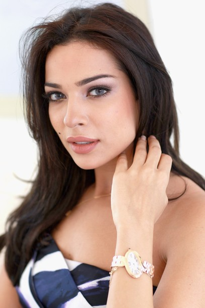 DUBAI, UNITED ARAB EMIRATES - FEBRUARY 18: Lebanese actress Nadine Njeim poses in the Cartier Villa at the Cartier International Dubai Polo Challenge at the Desert Palm Hotel on February 18, 2011 in Dubai, United Arab Emirates. The event takes place under the patronage of HRH Princess Haya Bint Al Hussein, wife of HH Sheikh Mohammed Bin Rashid Al Maktoum, Vice President and Prime Minister of UAE Ruler of Dubai. The Cartier International Dubai Polo Challenge is the most celebrated tournament in the desert and one of three Cartier hosts each year including the Royal Cartier International Windsor Polo and Saint-Moritz Snow Polo event. (Photo by Chris Jackson/Getty Images for Cartier)
